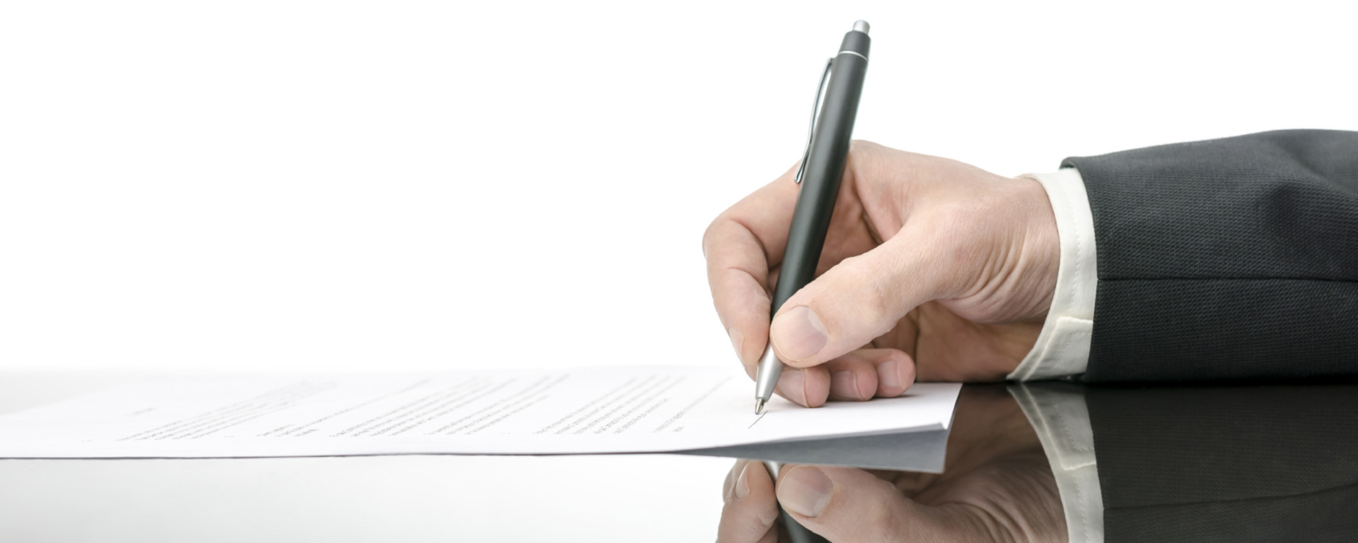 Signing a contract on a black table. With copy space and reflection.